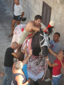 The ritual of dressing the horse during festivity of Saint Oronzo in Ostuni